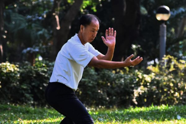 Person doing Tai Chi exercise
